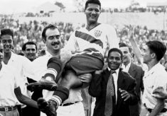** ADVANCE FOR WEEKEND EDITIONS, MAY 22-23  - FILE - ** In this June 28, 1950 file photo, United States soccer player Joe Gaetjens is carried off by cheering fans after the USA team beat England 1-0 in a World Cup soccer match in Belo Horizonte, Brazil. Talk football with Americans these days and the names Peyton Manning, Drew Brees and Roger Goodell are front and center. Next month, though, many Americans just might have Tim Howard, Landon Donovan and Bob Bradley on their minds. (AP Photo, File)